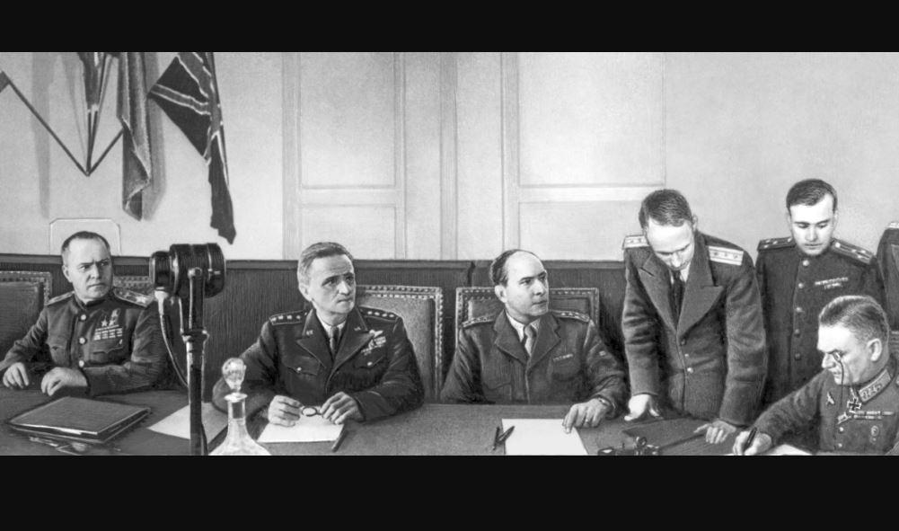 Подписание Акта о капитуляции вооружённых сил Германии. 8 мая 1945. Слева направо (сидят) Г. К. Жуков, К. Спаатс, Ж. М. Г. де Латр де Тассиньи; крайний справа В. Кейтель...